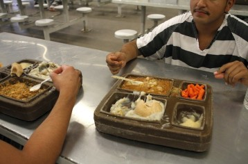 prisoners eating - shows tray - takepart.com